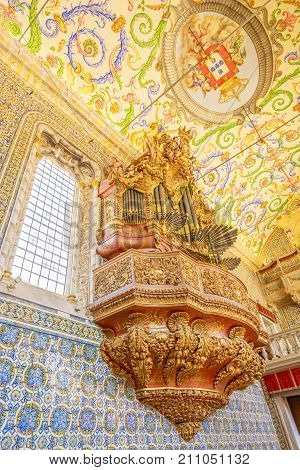 Coimbra, Portugal - August 14, 2017: details of pipe organ inside of Capela de Sao Miguel, the Chapel of University of Coimbra, a tourist attraction of university in upper Coimbra, Central Portugal.