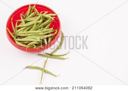 Green beans in red bowl - studio shot