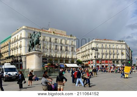 MADRID - JUN. 8, 2013: Statue of Carlos III and Puerta del Sol Gateway of the Sun, Madrid, Spain. Carlos III Charles III was the King of Spain from 1759 to 1788.