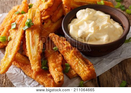 Fast Food: Fried Baby Corn With Green Onions And Sauce Close-up. Horizontal