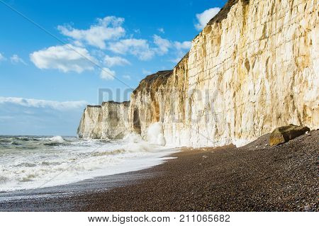 Chalk cliffs between Seaford and Newhaven, near Tide Mills, East Sussex, Enlgand in a high tide, selective focus