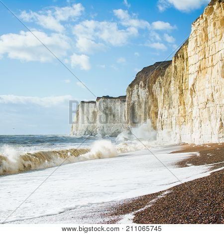 Chalk cliffs between Seaford and Newhaven, near Tide Mills, East Sussex, Enlgand on a windy day in a high tide, square, selective focus