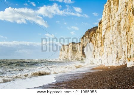 Chalk cliffs between Seaford and Newhaven, near Tide Mills, East Sussex, Enlgand on a windy day in a high tide, selective focus