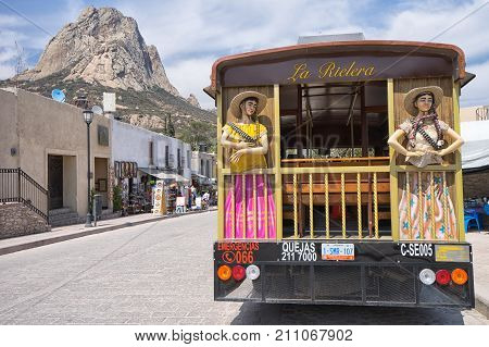 February 26 2016 Bernal Queretaro Mexico: tourist tour bus in the popular destination town with the peak of the large monolith in the background