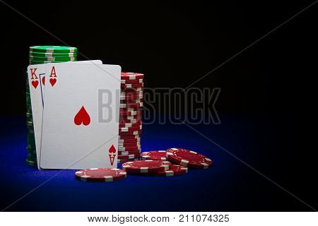 King and ace poker card on stack of poker chips