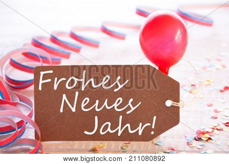 One Label With German Text Frohes Neue Jahr Means Happy New Year. Party Decoration Like Streamer, Confetti And Balloon. Wooden Background With Vintage, Retro Or Rustic Syle