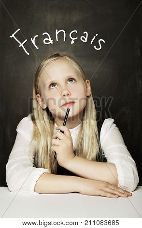 Child Girl Learning French on the School Classroom Blackboard Background