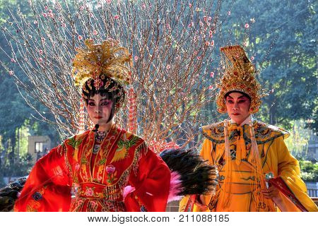 CANTON, CHINA - CIRCA JANUARY 2017: The two singers of Cantonese opera performer in the park.