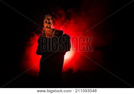 Female Demon. Demons Coming. Slhouette Of Devil Or Monster Figure On A Background Of Fire