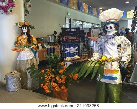 XALAPA, VERACRUZ, MEXICO- NOVEMBER 27, 2017: Skulls decoration dressed as chefs at a Day of the Dead festival in Xalapa, Veracruz, Mexico