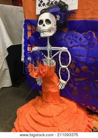 XALAPA, VERACRUZ, MEXICO- OCTOBER 27, 2017: Mexican catrina doll, made of papier maché. Part of a mexican day of the dead offering altar