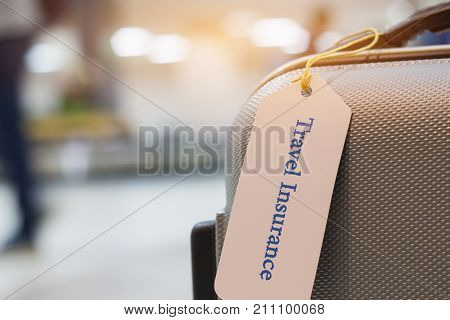 Travel Insurance tag on suitcase holder with tag tied letters enjoyable your trip on bag. Travel Insurance is intended cover medical expenses cover lost luggage flight cancellation or accident.