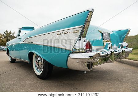 Westlake Texas - October 21 2017: Back side view of an aqua color 1957 Chevrolet Bel Air convertible classic car.
