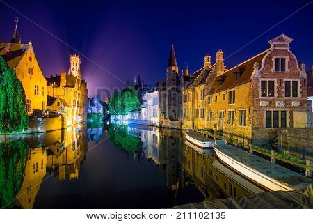 View from the Rozenhoedkaai in Brugge with the Perez de Malvenda house and Belfort van Brugge in the background at night, Belgium.