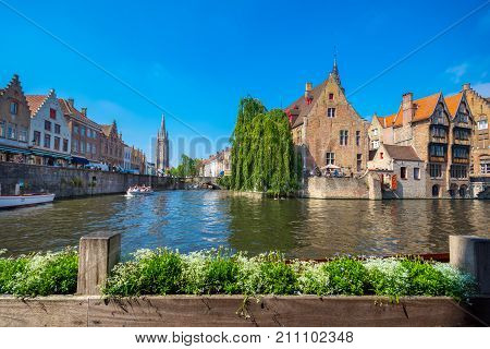 View from the Rozenhoedkaai in Brugge with the Perez de Malvenda house and Belfort van Brugge in the background in day light, Belgium on July 08, 2017.