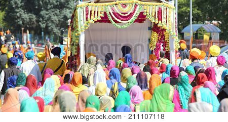 Group Of People With Colorful Clothes And Women With Veil In The