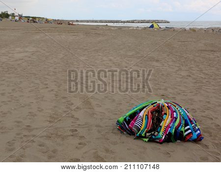 Heap Of Towels Abounding On The Beach By An Abusive Seller After