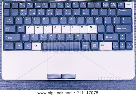 The inscription on the laptop keyboard - vacation