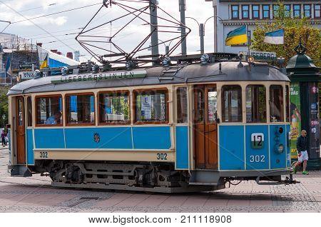 Gothenburg Sweden - June 30. 2013: blue vintage Tram driving on the Liseberg line