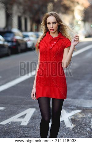 Young Blonde Woman Walking In The Street