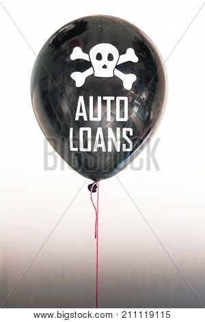 Black balloon with the word 'debt' representing the economic financial consumer student and auto loan debt bubble.