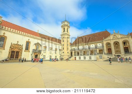 Coimbra, Portugal - August 14, 2017: main square of Coimbra University, the oldest university of Portugal with Patio das Escolas and Clock Tower. The University is one of the city's major attractions.