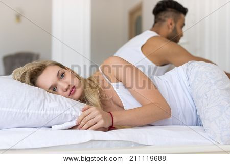 Young Couple Lying In Bed, Having Conflict Problem, Sad Negative Emotions Hispanic Man And Woman Lovers In Bedroom