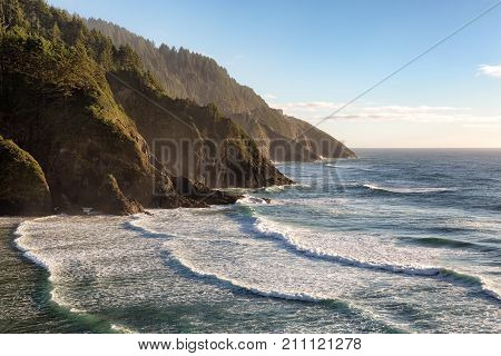 View from the Heceta Head lighthouse overlooking scenic Cape Cove on the Oregon pacific coast line.