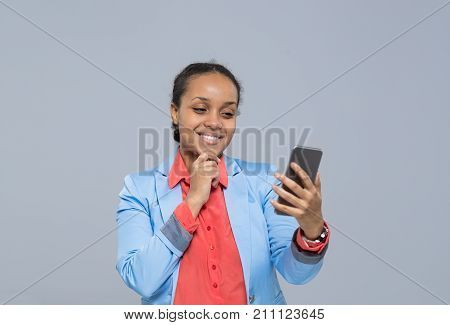 Young Business Woman Using Cell Smart Phone African American Girl Happy Smile Businesswoman Isolated Over Gray Background