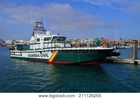 Corralejo, Fuerteventura, Canary Islands, Spain - October 24, 2017: Spanish Guardia Civil nautical Coastal patrol, surveillance and rescue vessel (Rodman 66), in the harbor of Corralejo.