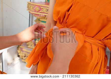 Monk dressing from master to new monk. Thai culture when a man is over 20 years old.
