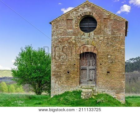 The Facade Of A Small And Abandoned Chapel Next To The Abbey Of San Galgano In Chiusdino