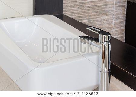 Chrome bathroom faucet. Bathroom water tap. Modern faucet. Bathroom interior. Modern design. Luxury faucet. Modern water tap. Chrome faucet