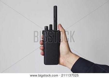 Portable walkie talkie radio transceiver in man's hand
