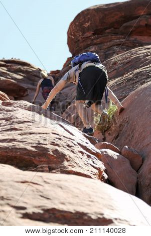 SEDONA, ARIZONA, OCTOBER 11. The Cathedral Rock Trail on October 11, 2017, near Sedona, Arizona. As Cathedral Rock Trail Steepens Hikers Must Become Climbers Near Sedona in Arizona.