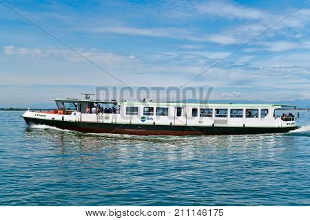 VENICE,ITALY - JULY 27, 2017 : Vaporetto or water bus on the lagoon of Venice