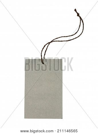 Blank decorative cardboard paper gift tag with twine tie isolated on white with clipping path