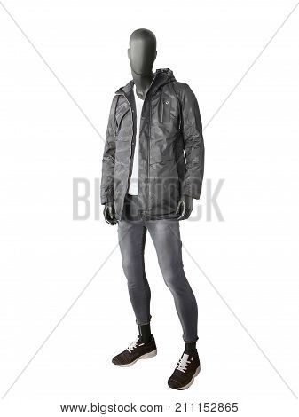 Full-length male mannequin dressed in a jacket with hood and gray jeans isolated on white background.