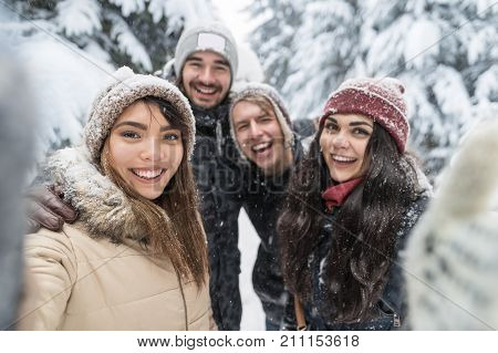 Friends Taking Selfie Photo Smile Snow Forest Young People Group Outdoor Winter Pine Woods