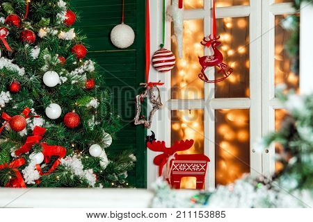House porch and window decorated for christmas and New Year holiday