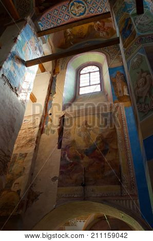 VELIKY NOVGOROD RUSSIA- AUGUST 11 2017. Interior view of Cathedral of Nativity of Our Lady St Anthony monastery in Veliky Novgorod Russia. Decorated ceiling with windows and fresco paintings