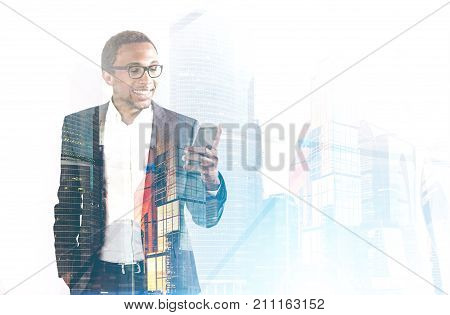 Smiling African American Man With Phone Foggy City