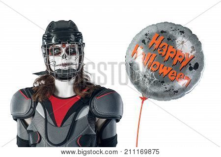 Happy halloween. hockey player in a hockey helmet and mask with a balloon against the isolated backdrop or background. holiday halloween. All Saints' Day