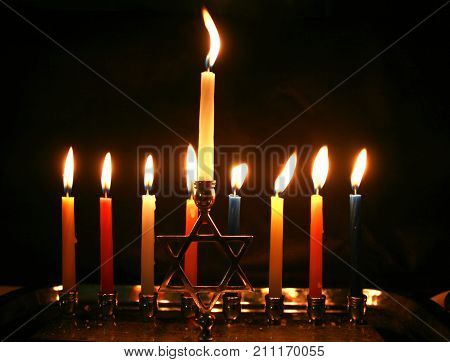 Burning Chanukah. The lit Chanukiah. Jewish holiday Hanukkah