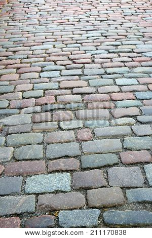 old way of colored granite stones, street