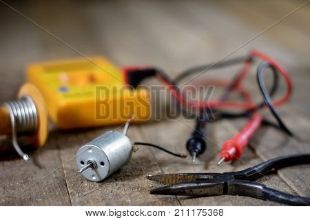 Electronic Workshop. Electric Meter And Soldering Iron.