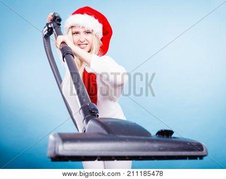 Girl In Santa Helper Hat With Vacuum Cleaner