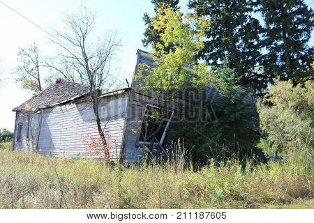 An old dilapidated building about to fall to ruins