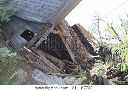 A dilapidated home fallen to ruin in a rural area