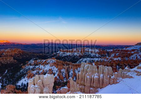 Beautiful dusk view of snowy Bryce Canyon National Park in Utah.